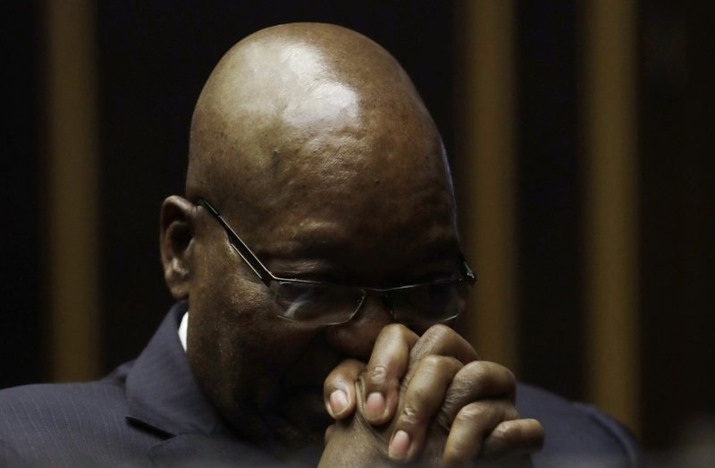 Former South African President Jacob Zuma gestures, in the High Court in Pietermaritzburg, South Africa, Friday, May 24, 2019. Zuma is in court facing charges of corruption, money laundering and racketeering. (AP Photo/Themba Hadebe, Pool)