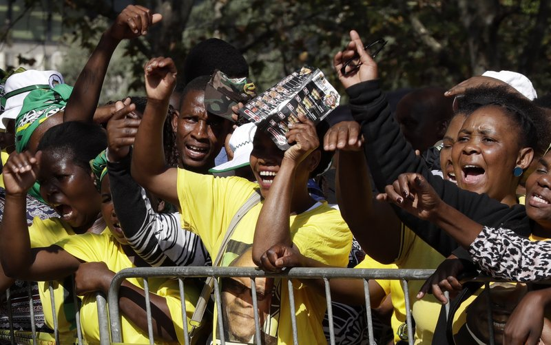 Supporters of the former South African President Jacob Zuma react as he addresses them outside the High Court in Pietermaritzburg, South Africa, Friday May 24, 2019. Zuma is in court facing charges of corruption, money laundering and racketeering. (AP Photo/Themba Hadebe)