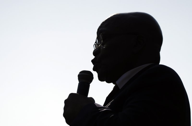 Former South African President Jacob Zuma addresses supporters after appearing at the High Court in Pietermaritzburg, South Africa, Friday May 24, 2019. Zuma is in court facing charges of corruption, money laundering and racketeering. (AP Photo/Themba Hadebe)