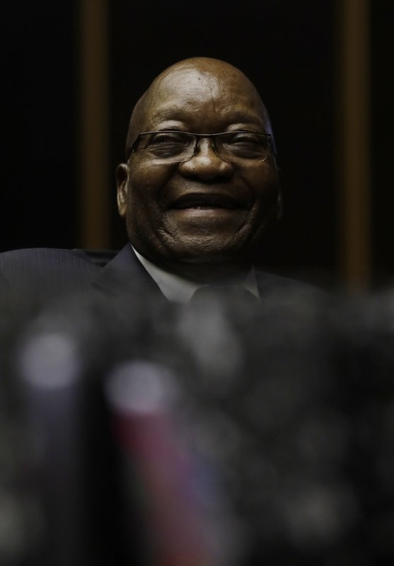 Former South African President Jacob Zuma smiles, in the High Court in Pietermaritzburg, South Africa, Friday, May 24, 2019. Zuma is in court facing charges of corruption, money laundering and racketeering. (AP Photo/Themba Hadebe, Pool)
