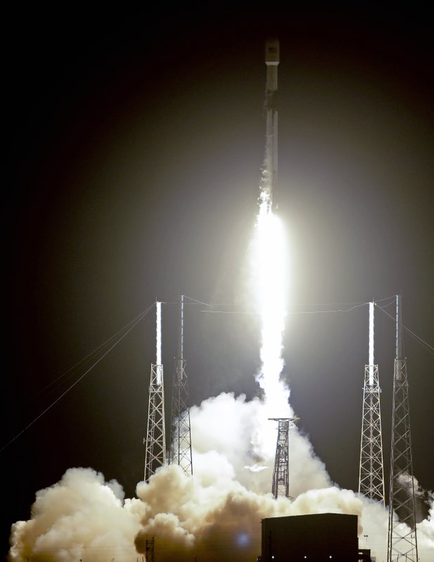 A Falcon 9 SpaceX rocket, with a payload of 60 satellites for SpaceX's Starlink broadband network, lifts off from Space Launch Complex 40 at the Cape Canaveral Air Force Station in Cape Canaveral, Fla., Thursday, May 23, 2019. (AP Photo/John Raoux)