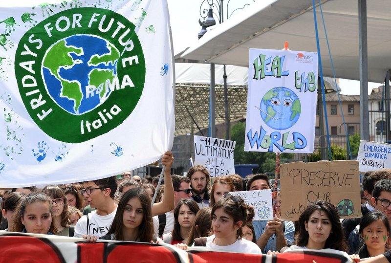 Young demonstrators take part in a demonstration organised by 'Global Strike 4 Climate' beneath the Monument of the Unknown Soldier, in Rome, Friday, May 24, 2019. (Maurizio Brambatti/ANSA via AP)