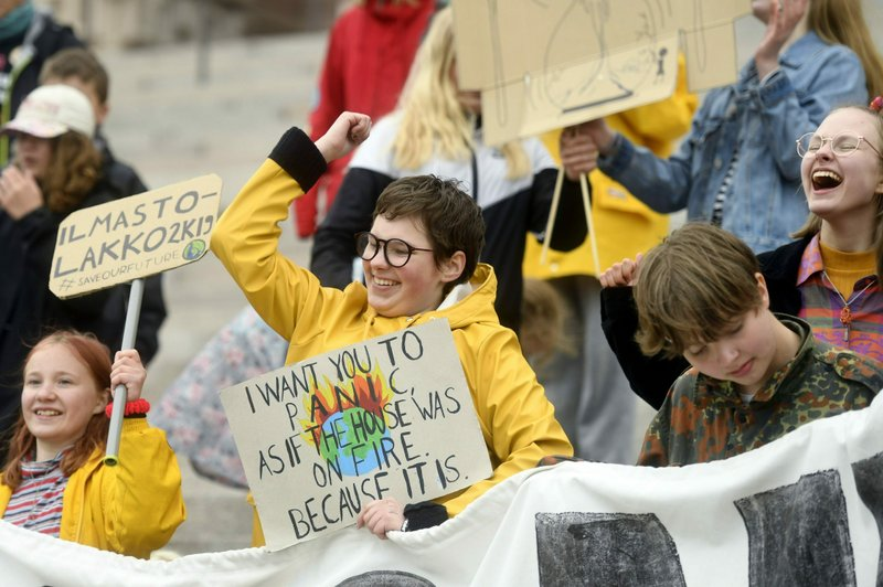 Young climate activists demonstrate in front of the Finnish Parliament building in Helsinki, Finland, Friday May 24, 2019, a global day of student protests aiming to spark world leaders into action on climate change. (Vesa Moilanen/Lehtikuva via AP)