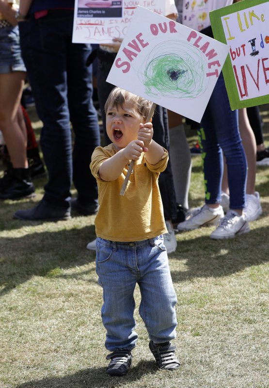 A young protestor takes part in a demonstration organised by 'Global Strike 4 Climate' in Parliament Square in London, Friday, May 24, 2019. (AP Photo/Kirsty Wigglesworth)