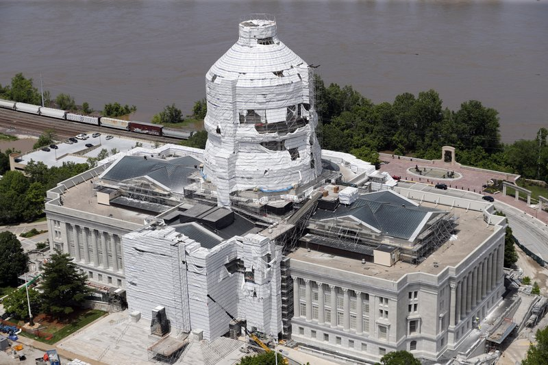 In this aerial photograph, the Missouri Capitol is seen Thursday, May 23, 2019, in Jefferson City, Mo. Material covering part of the exterior of the building as it undergoes a renovation was damaged during a strong storm overnight. (AP Photo/Jeff Roberson)