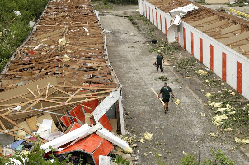 Workers pick up debris at destroyed storage units Thursday, May 23, 2019 after a tornado tore though Jefferson City, Mo. late Wednesday. (AP Photo/Charlie Riedel)