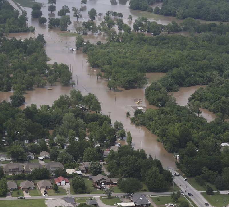 In this aerial image, flood waters are seen on North Cincinnati near Skiatook, Okla., on Thursday, May 23, 2019. Storms and torrential rains have ravaged the Midwest, from Texas through Oklahoma, Kansas, Nebraska, Iowa, Missouri and Illinois, in the past few days. (Tom Gilbert/Tulsa World via AP)