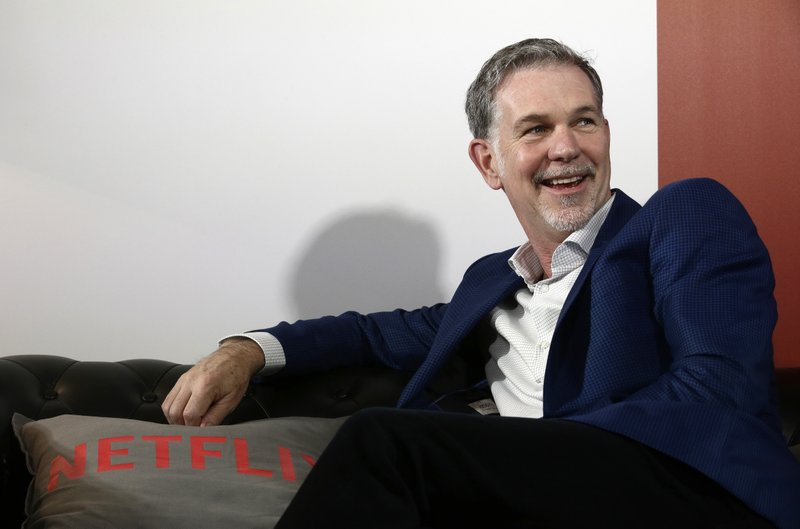 FILE - In this Feb. 28, 2017, file photo, Netflix Founder and CEO Reed Hastings smiles during an interview in Barcelona, Spain. Hastings was the seventh-highest paid CEO at big U.S. companies for 2018, as calculated by The Associated Press and Equilar, an executive data firm. He made $36.1 million. (AP Photo/Manu Fernandez, File)