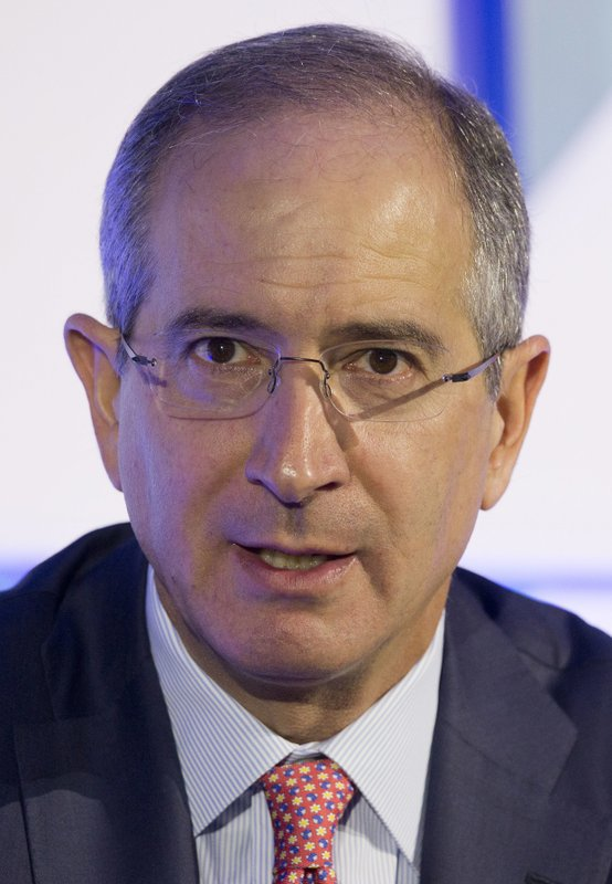 FILE - In this Dec. 8, 2015, file photo, Comcast chairman and CEO Brian Roberts speaks at the conference
