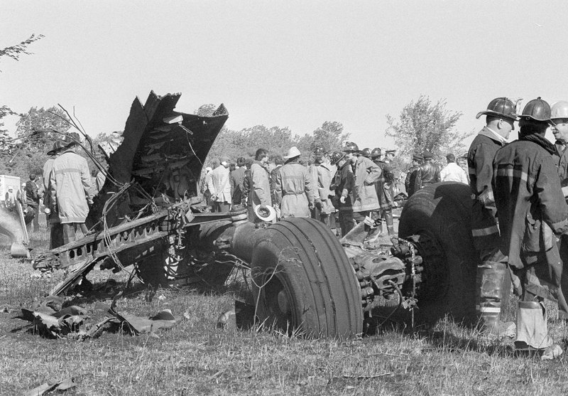 FILE - In this May 25, 1979 photo, a portion of the landing gear of an American Airlines DC-10 lies in foreground as firemen and emergency personnel survey wreckage scene northwest of O'Hare International Airport in Chicago. Decades later, the crash of American Airlines Flight 191 moments after it took off from Chicago's O'Hare International Airport remains the deadliest aviation accident in U.S. history. The DC-10 was destined for Los Angeles when it lost one of its engines May 25, 1979, killing what investigators later determined were 273 people _ all 271 people aboard the jetliner and two people on the ground. (AP Photo/Fred Jewell File)