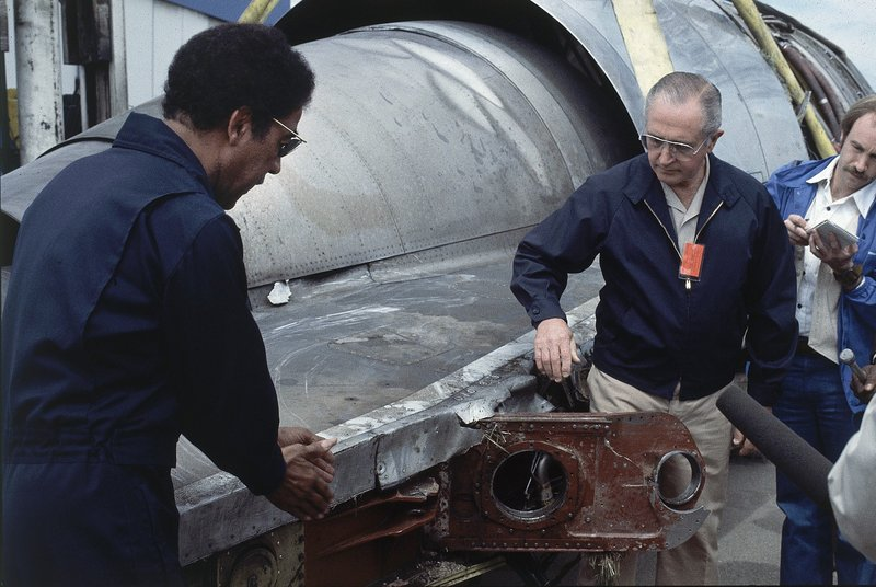 FILE - In this May 26, 1979 photo, William Schaefer of American Airlines, right, and Elwood Driver of the National Transportation Safety Board, left, examine the engine that fell off the DC-10 in Chicago, Ill., Decades later, the crash of American Airlines Flight 191 moments after it took off from O'Hare International Airport remains the deadliest aviation accident in U.S. history. The DC-10 was destined for Los Angeles when it lost one of its engines May 25, 1979, killing what investigators later determined were 273 people _ all 271 people aboard the jetliner and two people on the ground. (AP Photo/Fred Jewell File)