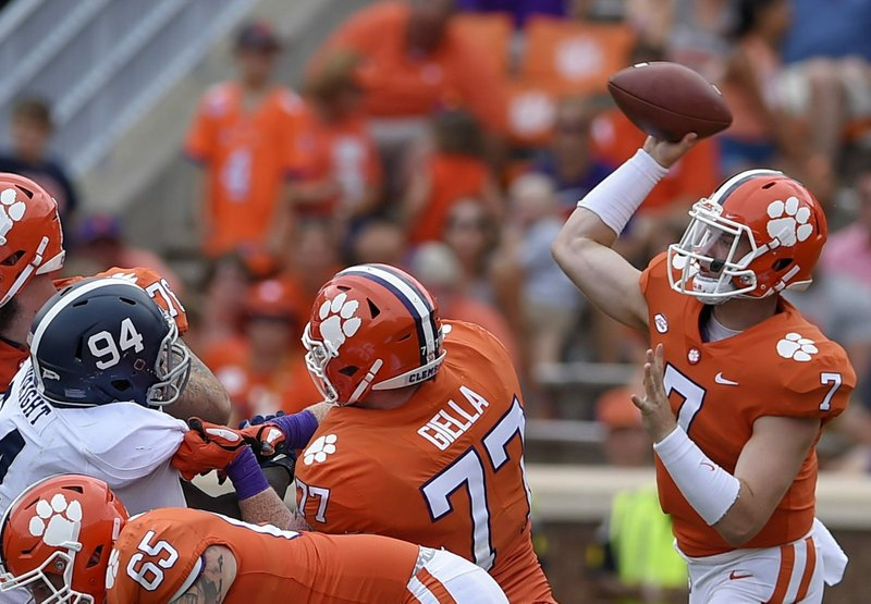 FILE - In this Sept. 15, 2018, file photo, Clemson quarterback Chase Brice delivers a pass as Zach Giella (77) blocks during the second half of an NCAA college football game in Clemson, S.C. Clemson tight end Braden Galloway and offensive lineman Zach Giella will miss next season after an NCAA panel rejected the school's appeal of their drug suspension. Clemson athletic spokesman Jeff Kallin said the school learned of the NCAA's decision on Wednesday, May 22, 2019. (AP Photo/Richard Shiro, File)