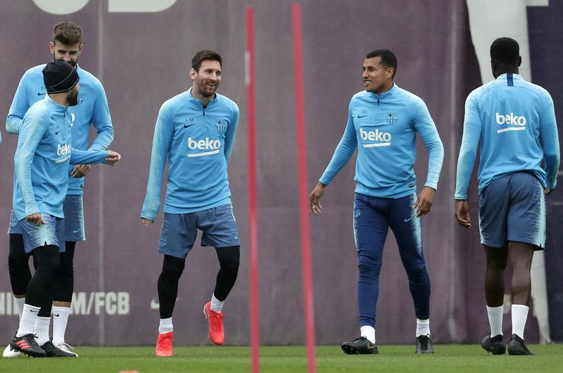 FC Barcelona's Lionel Messi, center left takes part in a training session with teammates at the Sports Center FC Barcelona Joan Gamper in Sant Joan Despi, Spain, Friday, May 24, 2019. FC Barcelona will play against Valencia in the Spanish Copa del Rey soccer match final on Saturday. (AP Photo/Manu Fernandez)