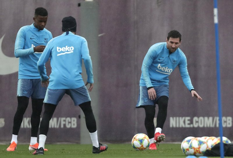 FC Barcelona's Lionel Messi, right, kicks the ball during a training session at the Sports Center FC Barcelona Joan Gamper in Sant Joan Despi, Spain, Friday, May 24, 2019. FC Barcelona will play against Valencia in the Spanish Copa del Rey soccer match final on Saturday. (AP Photo/Manu Fernandez)