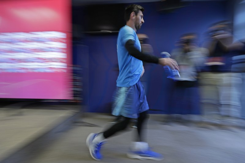FC Barcelona's Lionel Messi leaves a press conference at the Sports Center FC Barcelona Joan Gamper in Sant Joan Despi, Spain, Friday, May 24, 2019. FC Barcelona will play against Valencia in the Spanish Copa del Rey soccer match final on Saturday. (AP Photo/Manu Fernandez)