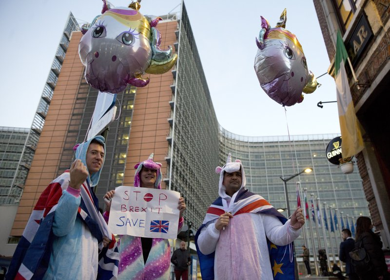 In this Wednesday, Feb. 20, 2019 file photo, protestors in costume and wearing Union and EU flags demonstrate against the Brexit process outside EU headquarters in Brussels. As British Prime Minister Theresa May announced her departure with a Brexit plan nowhere near success, European Union leaders offered kind words. But it was quite another matter during the years of negotiations with the bloc that often produced exasperation, miscommunication and even some ridicule of her.(AP Photo/Virginia Mayo, File)