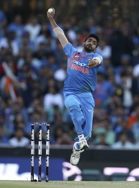 FILE - In this Sunday Nov. 25, 2018 file photo, India's Jasprit Bumrah bowls during their T20 cricket match against Australia in Sydney. The 2019 Cricket World Cup starts in England on May 31. (AP Photo/Rick Rycroft, File)
