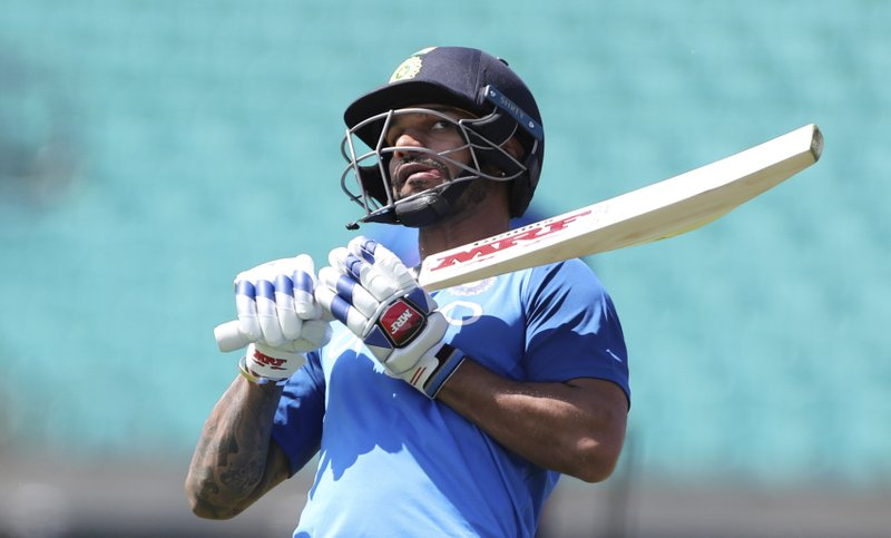 India's Shikhar Dhawan bats in the nets during a training session at The Oval in London, Thursday, May 23, 2019. The Cricket World Cup starts on Thursday May 30. (AP Photo/Aijaz Rahi)
