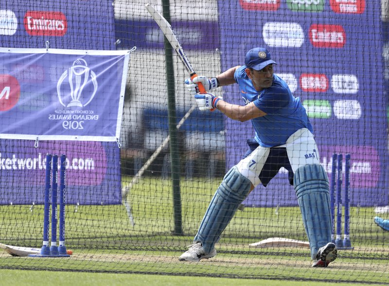 India's Mahendra Singh Dhoni bats in the nets during a training session at The Oval in London, Thursday, May 23, 2019. The Cricket World Cup starts on Thursday May 30. (AP Photo/Aijaz Rahi)