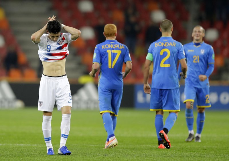 United States' Sebastian Soto, left, reacts at the end of the Group D U20 World Cup soccer match between Ukraine and USA in Bielsko Biala, Poland, Friday, May 24, 2019. (AP Photo/Sergei Grits)