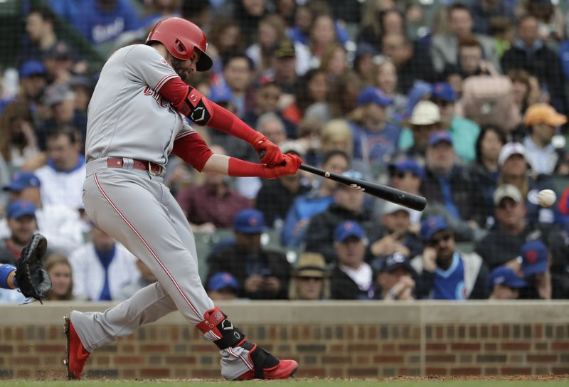 Cincinnati Reds' Jesse Winker hits a one-run double against the Chicago Cubs during the seventh inning of a baseball game Friday, May 24, 2019, in Chicago. (AP Photo/Nam Y. Huh)