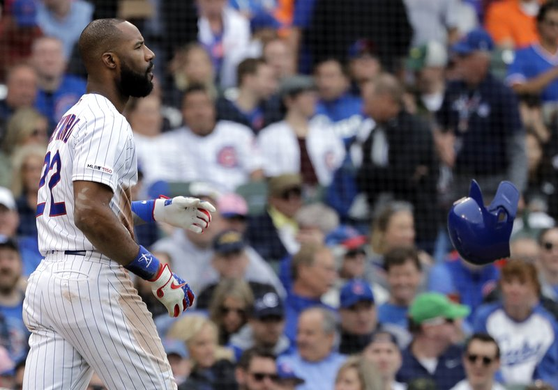Chicago Cubs' Jason Heyward throws his helmet after striking out swinging during the fifth inning of a baseball game against the Cincinnati Reds, Friday, May 24, 2019, in Chicago. (AP Photo/Nam Y. Huh)