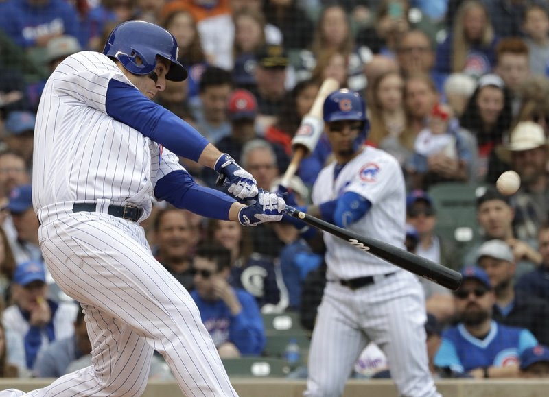 Chicago Cubs' Anthony Rizzo hits a solo home run during the third inning of a baseball game against the Cincinnati Reds, Friday, May 24, 2019, in Chicago. (AP Photo/Nam Y. Huh)