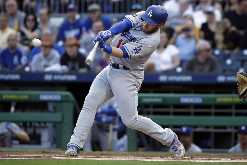 Los Angeles Dodgers' Max Muncy drives in a run with a double off Pittsburgh Pirates starting pitcher Michael Feliz during the first of a baseball game in Pittsburgh, Friday, May 24, 2019. (AP Photo/Gene J. Puskar)