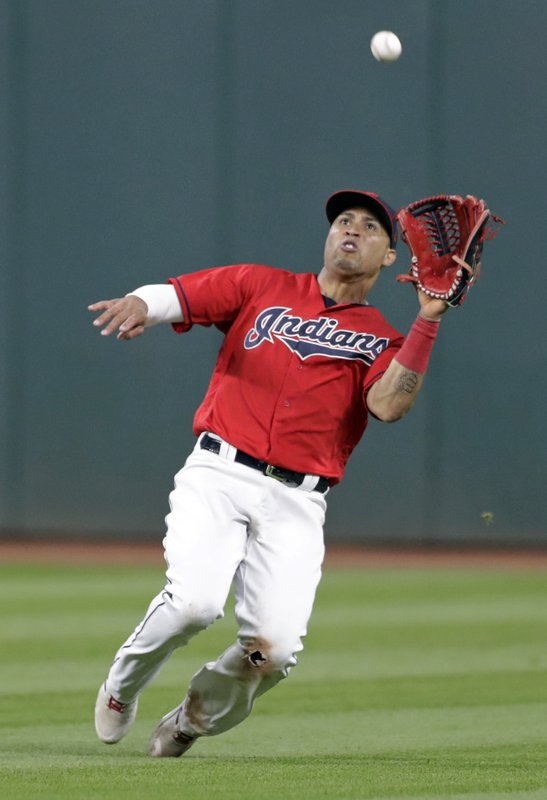 Cleveland Indians' Leonys Martin catches a ball hit by Tampa Bay Rays' Avisail Garcia during the seventh inning of a baseball game, Friday, May 24, 2019, in Cleveland. Garcia was out on the play. (AP Photo/Tony Dejak)