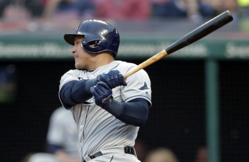 Tampa Bay Rays' Avisail Garcia watches his RBI single off Cleveland Indians starting pitcher Shane Bieber during the first inning of a baseball game Friday, May 24, 2019, in Cleveland. Austin Meadows scored on the play. (AP Photo/Tony Dejak)
