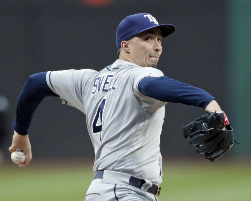 Tampa Bay Rays starting pitcher Blake Snell delivers in the first inning of the team's baseball game against the Cleveland Indians, Friday, May 24, 2019, in Cleveland. (AP Photo/Tony Dejak)