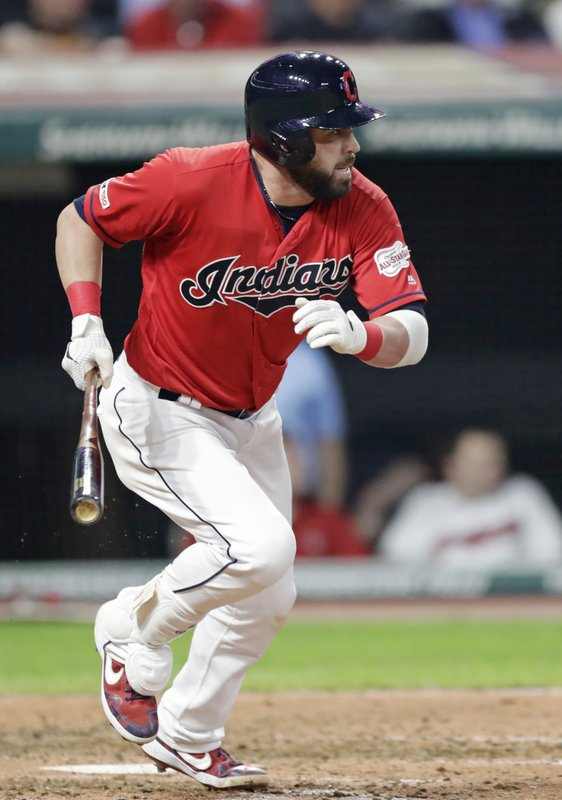 Cleveland Indians' Jason Kipnis heads to first with a single off Tampa Bay Rays starting pitcher Blake Snell durimg the sixth inning of a baseball game Friday, May 24, 2019, in Cleveland. (AP Photo/Tony Dejak)
