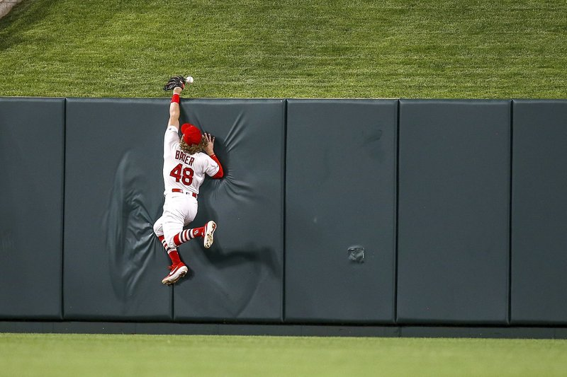 St. Louis Cardinals center fielder Harrison Bader (48) is unable to catch a two-run home run hit by Atlanta Braves' Dansby Swanson during the eighth inning of a baseball game Friday, May 24, 2019, in St. Louis. (AP Photo/Scott Kane)