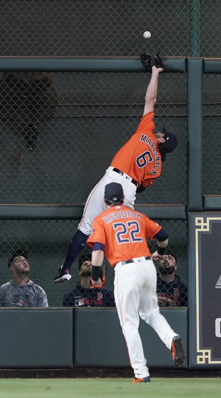 Houston Astros center fielder Jake Marisnick (6) tries to catch a double by Boston Red Sox's Mookie Betts as right fielder Josh Reddick (22) watches during the fourth inning of a baseball game Friday, May 24, 2019, in Houston. (AP Photo/David J. Phillip)