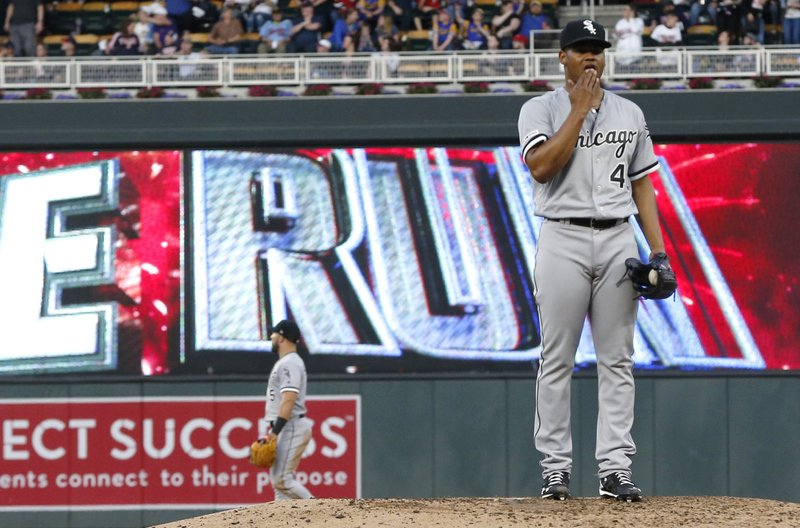 Chicago White Sox pitcher Reynaldo Lopez stands on the mound after giving up a solo home run to Minnesota Twins' Eddie Rosario during the third inning of a baseball game Friday, May 24, 2019, in Minneapolis. (AP Photo/Jim Mone)