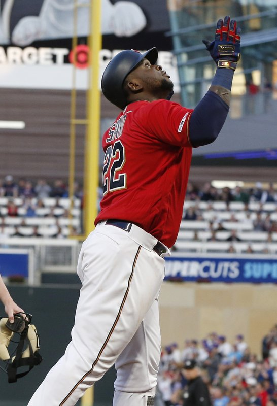 Minnesota Twins' Miguel Sano celebrates his solo home run against the Chicago White Sox, as he crosses the plate during the third inning of a baseball game Friday, May 24, 2019, in Minneapolis. (AP Photo/Jim Mone)