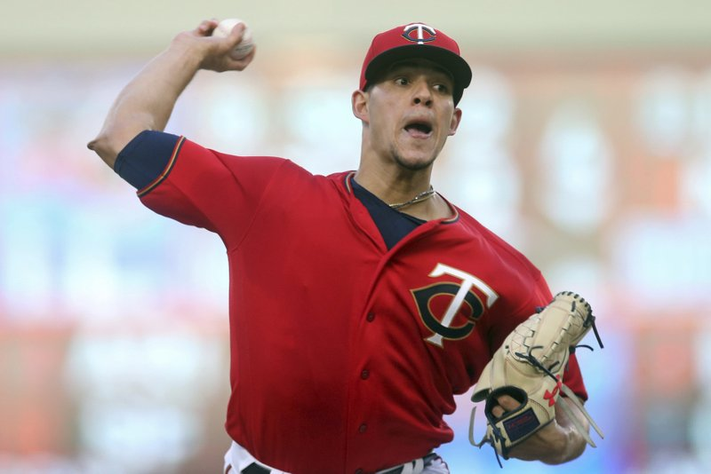 Minnesota Twins pitcher Jose Berrios throws against the Chicago White Sox during the first inning of a baseball game Friday, May 24, 2019, in Minneapolis. (AP Photo/Jim Mone)
