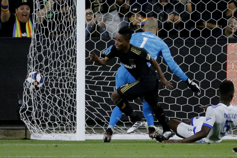 Los Angeles FC forward Latif Blessing (7) celebrates after scoring on Montreal Impact goalkeeper Evan Bush (1) during the first half of an MLS soccer match in Los Angeles, Friday, May 24, 2019. (AP Photo/Ringo H.W. Chiu)
