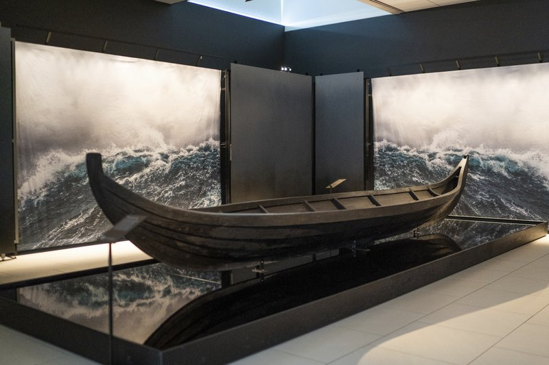 A replica of a Viking burial boat is on display inside of the American Swedish Institute's