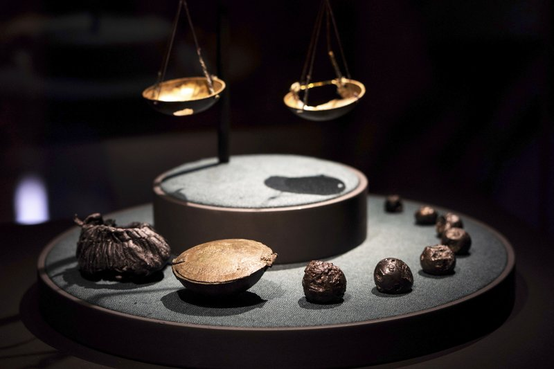 Pieces of silver, a leather carrying pouch and small scale used a by a Viking for trading are on display inside the American Swedish Institute's