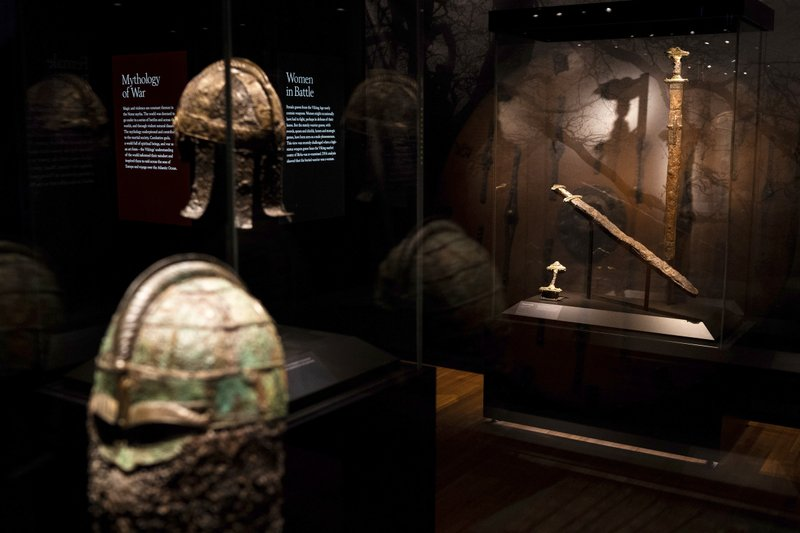 Viking helmets and swords sit on display at the American Swedish Insitute's