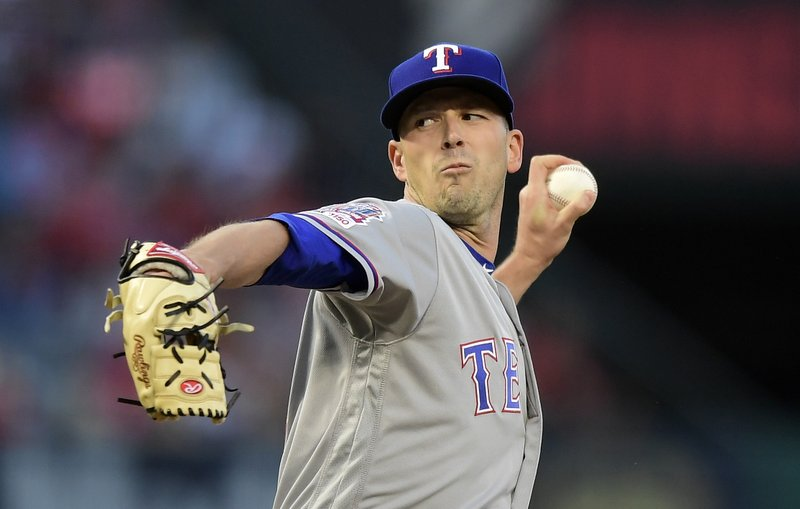 Texas Rangers starting pitcher Drew Smyly throws to the plate during the first inning of a baseball game against the Los Angeles Angels, Friday, May 24, 2019, in Anaheim, Calif. (AP Photo/Mark J. Terrill)
