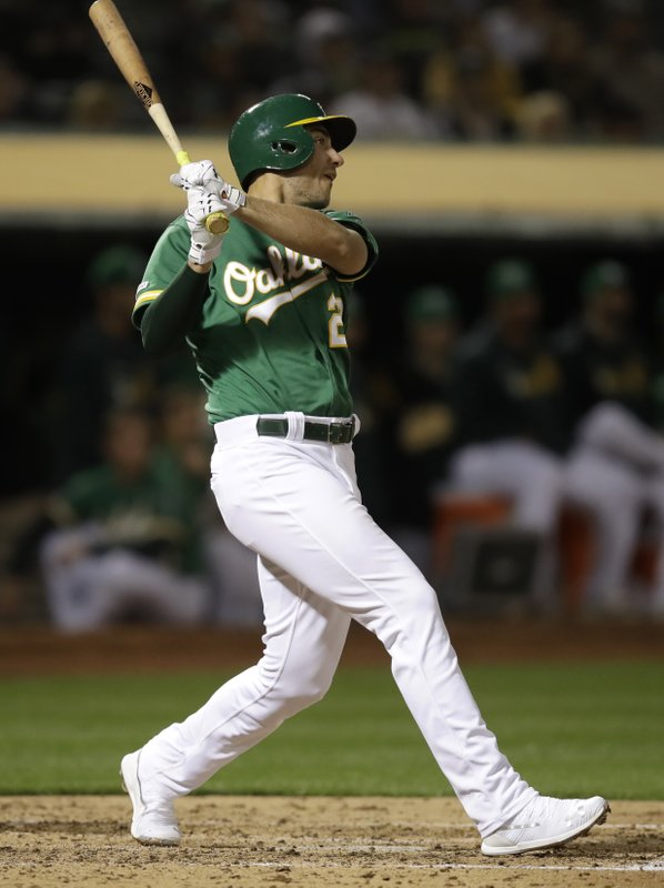 Oakland Athletics' Matt Olson watches his three-run home run off Seattle Mariners' Wade LeBlanc during the fourth inning of a baseball game Friday, May 24, 2019, in Oakland, Calif. (AP Photo/Ben Margot)