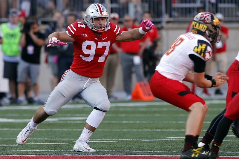 FILE - In this Oct. 7, 2017, file photo, Ohio State defensive end Nick Bosa rushes in against Maryland during an NCAA college football game in Columbus, Ohio. Bosa is hoping to return to form with the Los Angeles Chargers wearing a new yet familiar number. The defensive end has switched from No. 99 to 97. Bosa wore that number at St. Thomas Aquinas High School in Fort Lauderdale, Florida, and at Ohio State. It is also a significant number for the Bosa family. John Bosa wore No. 97 for three seasons in the NFL and Nick Bosa, Joey's younger brother, will wear it for San Francisco after being the second overall pick in the April draft. (AP Photo/Jay LaPrete, File)
