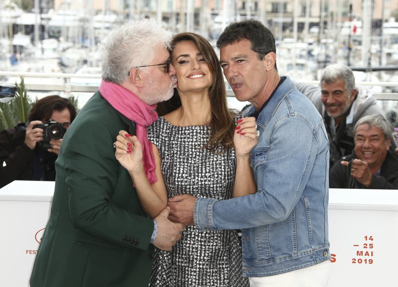 Actors Antonio Banderas, from right, Penelope Cruz and director Pedro Almodovar pose for photographers at the photo call for the film 'Pain and Glory' at the 72nd international film festival, Cannes, southern France, Saturday, May 18, 2019. (Photo by Joel C Ryan/Invision/AP)
