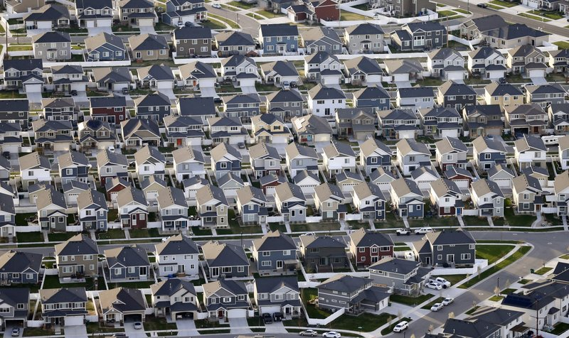 This April 13, 2019, photo, shows rows of homes, in suburban Salt Lake City. The Salt Lake City area is among the hottest spots for first-time buyers in part because of a staggering burst of home construction and a surge of high-tech jobs.  (AP Photo/Rick Bowmer)