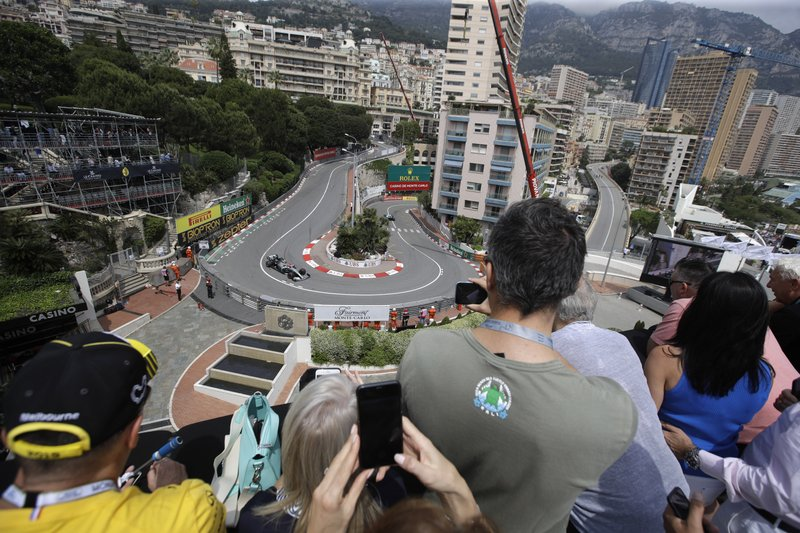 Spectators watch Mercedes driver Valtteri Bottas of Finland steers his car during the third free practice at the Monaco racetrack, in Monaco, Saturday, May 25, 2019. The Formula one race will be held on Sunday. (AP Photo/Luca Bruno)