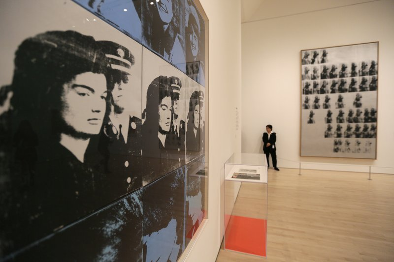 In this May 15, 2019, photo, images of Jackie Kennedy are displayed in a room on female icons at the exhibition