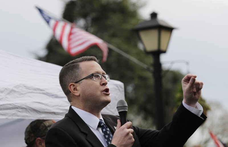 FILE - In this Jan. 18, 2019, file photo, Rep. Matt Shea, R-Spokane Valley, speaks at a gun-rights rally at the Capitol in Olympia, Wash. Recently published internet chats from 2017 show Shea and three other men discussing confronting