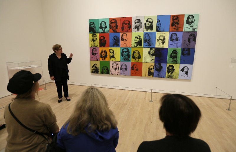 In this photo taken Wednesday, May 15, 2019, Donna DeSalvo, deputy director and senior curator at New York's Whitney Museum of American Art, talks about the piece